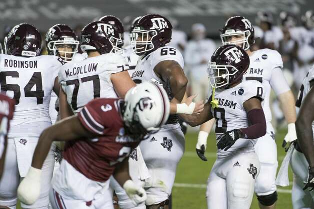 Texas A&M's Ryan McCollum (77) and Ainias Smith (0) celebrate a touchdown during the second half of the team's NCAA college football game against South Carolina on Saturday, Nov. 7, 2020, in Columbia, S.C. Texas A&M won 48-3. (AP Photo/Sean Rayford) Photo: Sean Rayford/Associated Press / The Associated Press