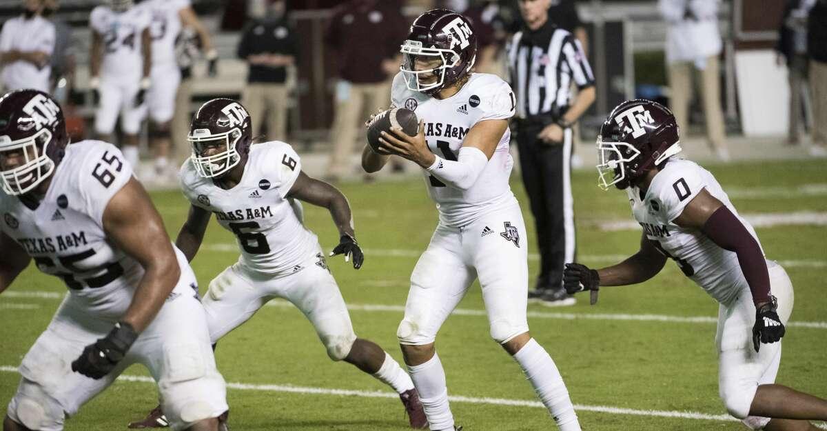 Texas A&M quarterback Kellen Mond (11) takes a snap during the second half of the team's NCAA college football game against South Carolina on Saturday, Nov. 7, 2020, in Columbia, S.C. Texas A&M won 48-3. (AP Photo/Sean Rayford)