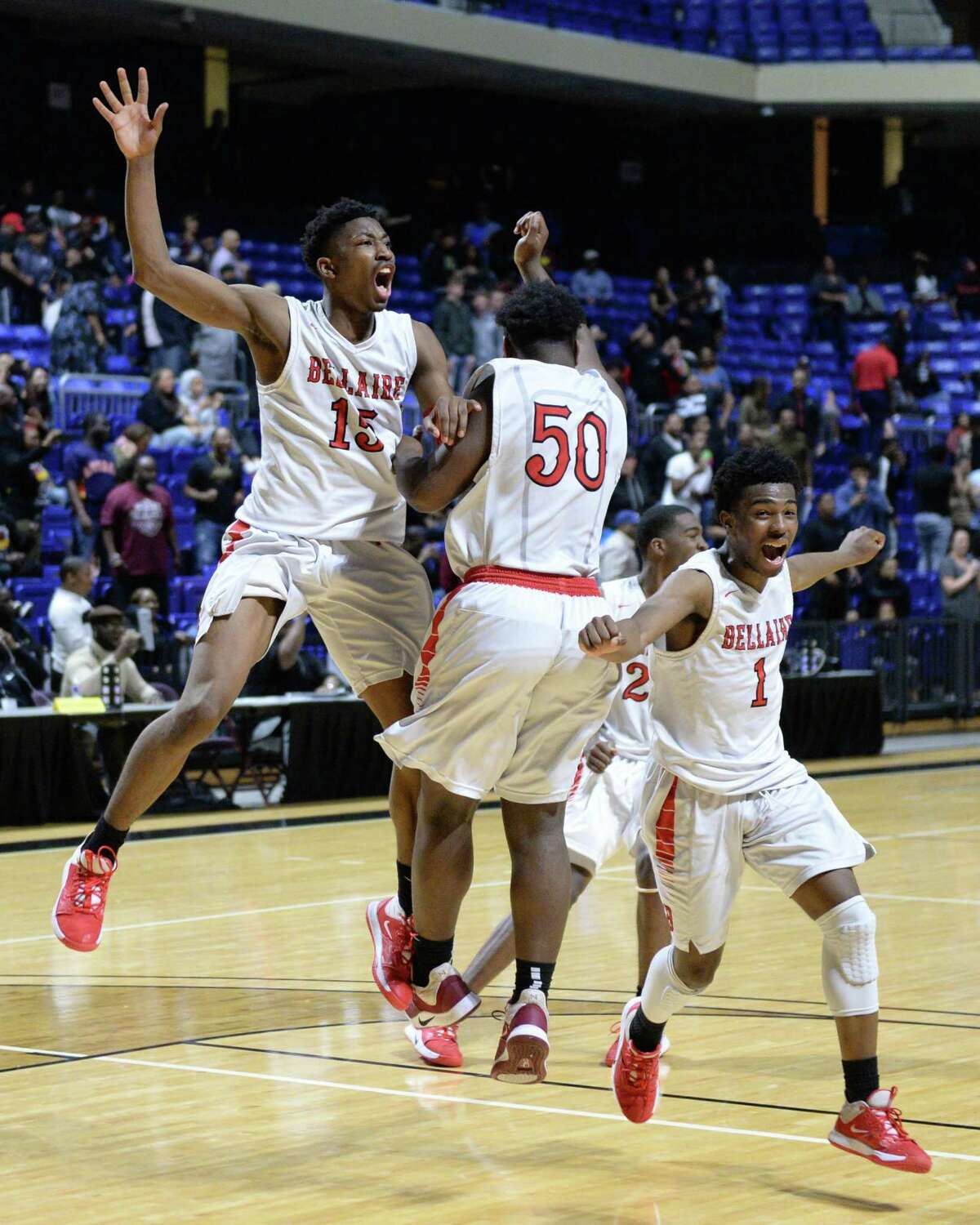 The Bellaire Cardinals celebrate their 61-59 victory over the Summer Creek Bulldogs in the Boys 6A Region III semifinal basketball game on Friday, March 6, 2020 at the Berry Center, Cypress, TX.