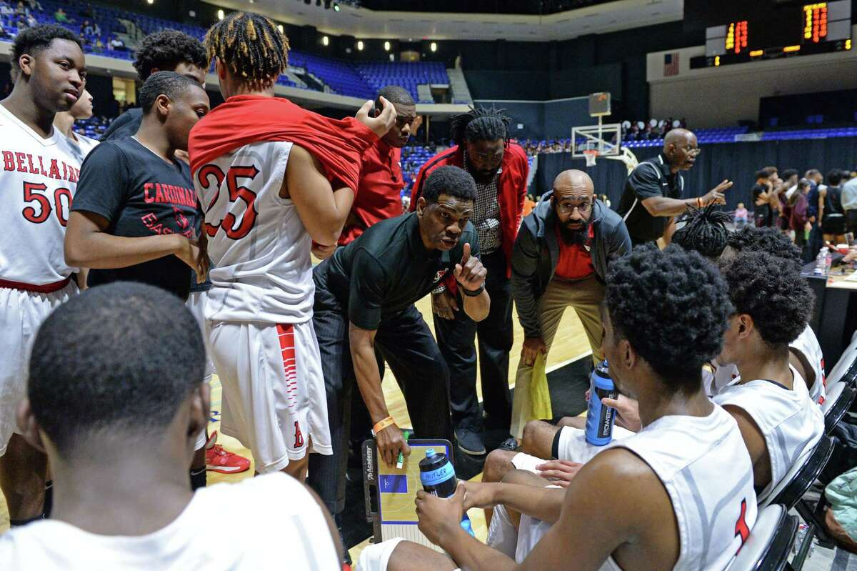 Cardinals Head Coach Bruce Glover (coach) of Bellaire talks to the team during a time-out in the fourth quarter of the Boys 6A Region III semifinal basketball game between the Bellaire Cardinals and the Summer Creek Bulldogs on Friday, March 6, 2020 at the Berry Center, Cypress, TX.