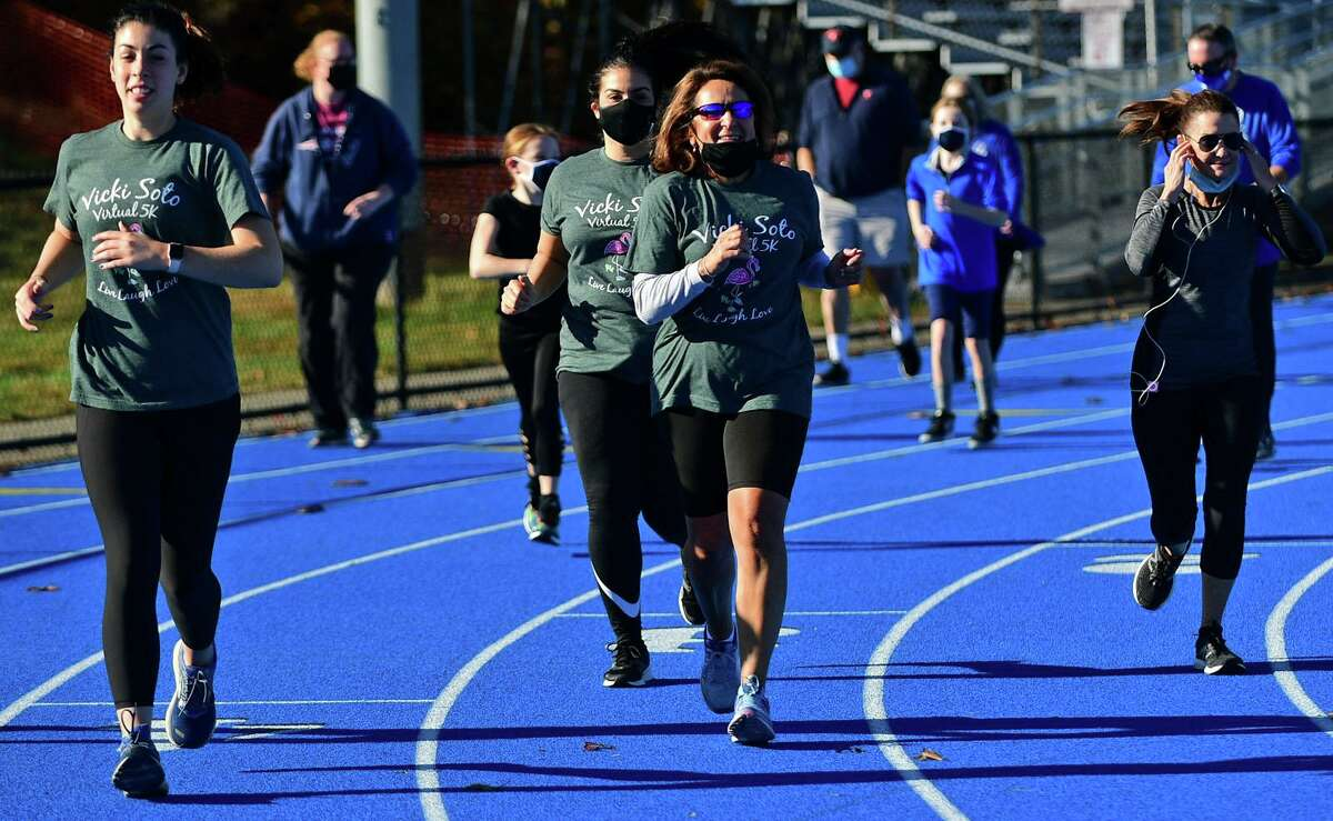 Bunnell High School faculty and their families run in the mini Vicki Soto 5K Saturday, November 7, 2020, in Stratford, Conn. The race supports four renewable $5,000 scholarships for high school students from Stratford.