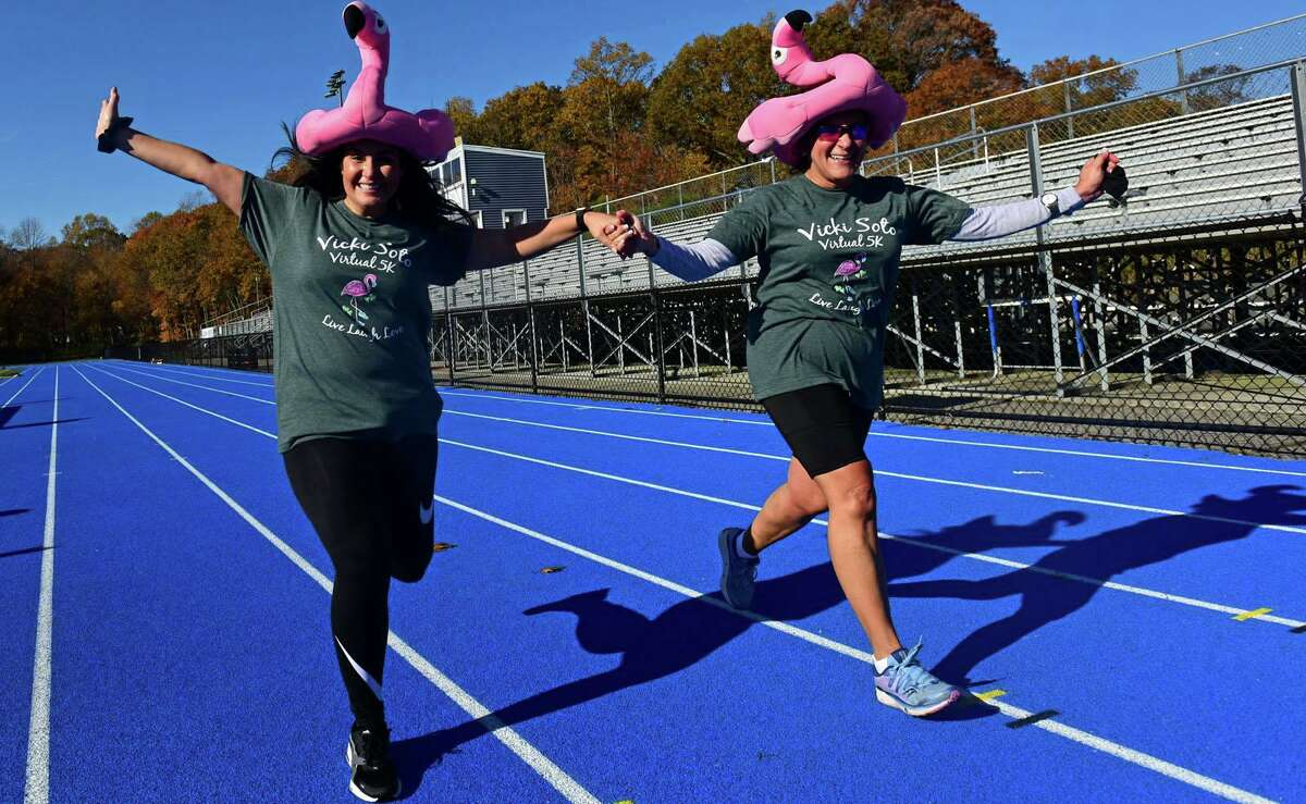 Bunnell High School faculty including counselor Amanda Cotella and principal Nancy Dowling and their families run in the mini Vicki Soto 5K Saturday, November 7, 2020, in Stratford, Conn. The race supports four renewable $5,000 scholarships for high school students from Stratford.
