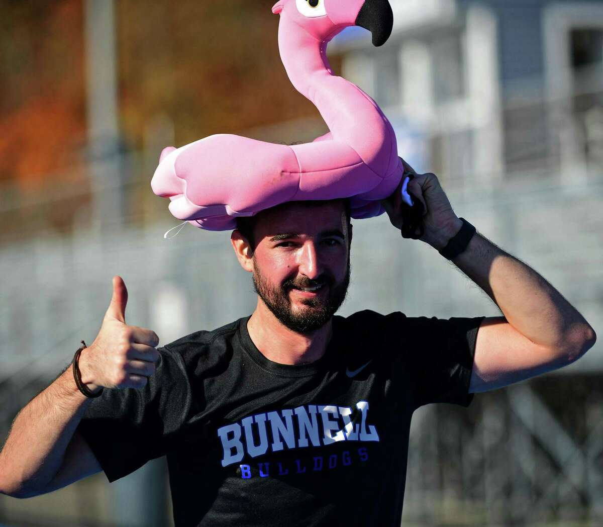 Bunnell High School faculty including Spanish teacher Jose Burguillos and their familes run in the mini Vicki Soto 5K Saturday, November 7, 2020, in Stratford, Conn. The race supports four renewable $5,000 scholarships for high school students from Stratford.