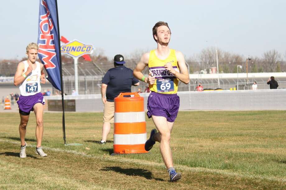 Owen Roth sprints to the finish in his final race for the Panthers at cross country state finals on Nov. 7 at Michigan International Speedway. Photo: Robert Myers