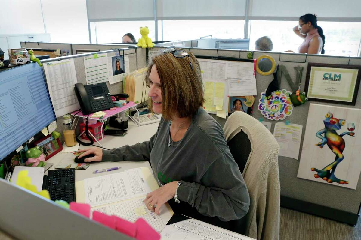 Nancy Roach, Senior Closer in the Mortgage Division, at her desk at the company offices of Chesmar Homes Monday, Oct. 5, 2020 in The Woodlands, TX.