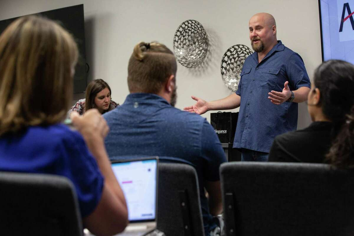 Chance Brown, broker and owner of CB&A, speaks at a new agent training in the office on Oct. 6, 2020.