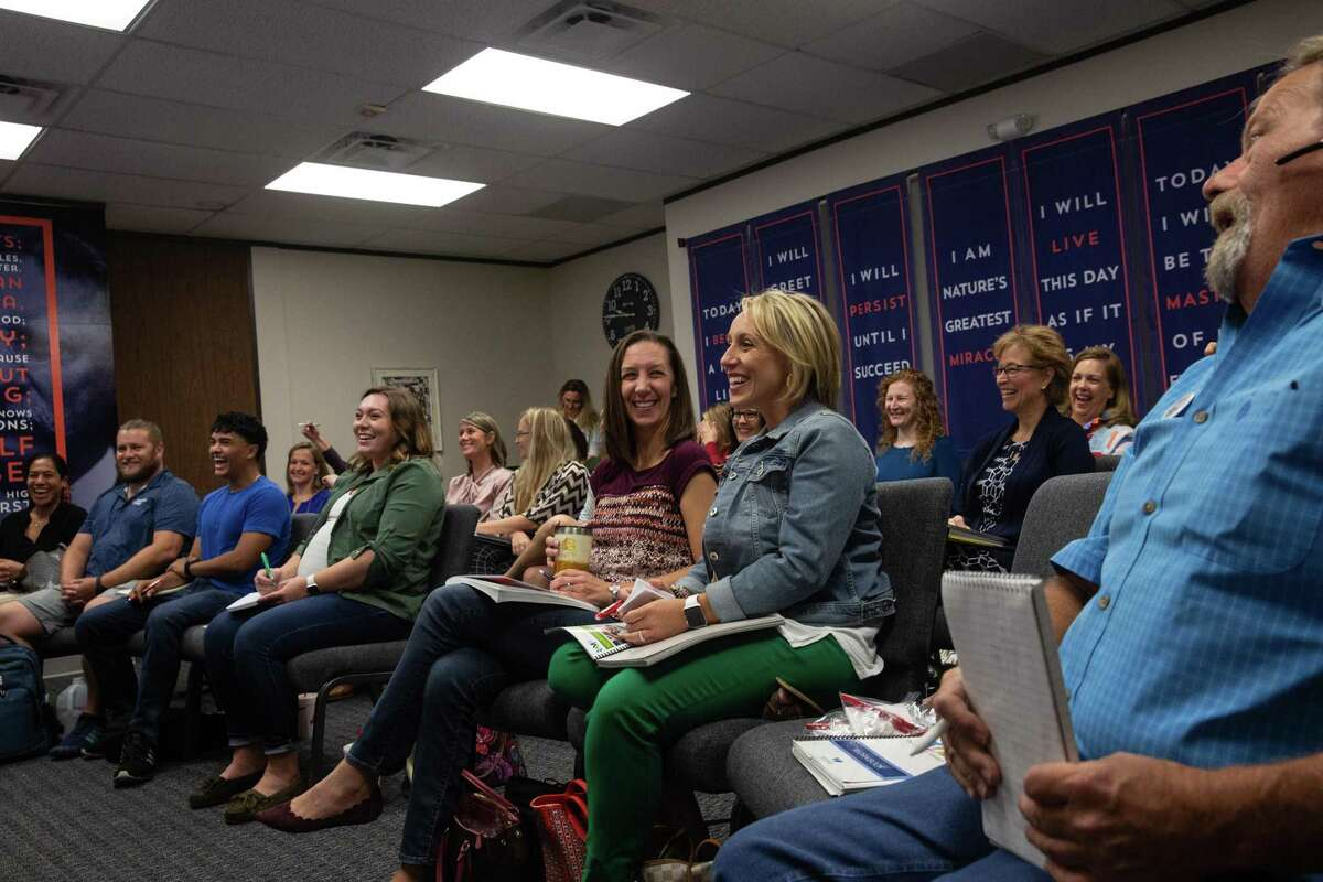 Julie Tyson and Pamela Post laugh during a CB&A Realtor training in the office on Oct. 6, 2020.