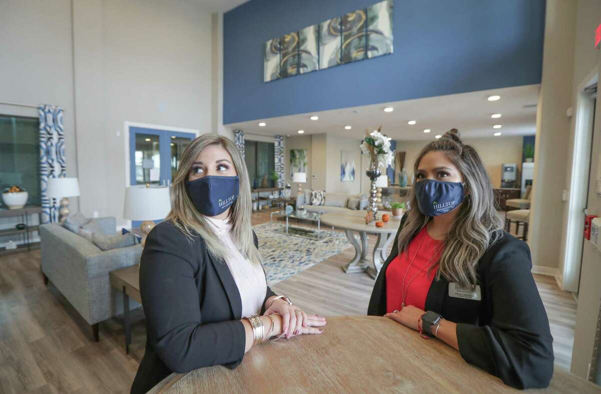 Leasing Consultant Sarah Henderson and Community Director Monica Bonilla are on-site employees for Hilltop Residential, working at the property at Waterside Village in Richmond.