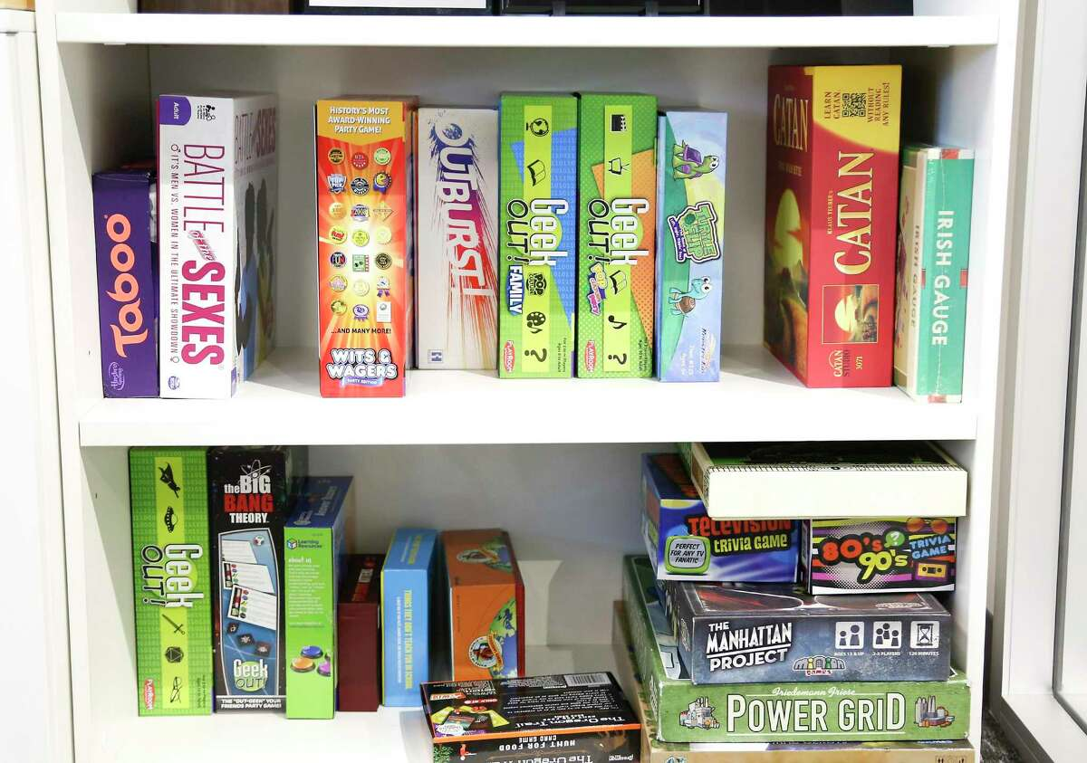 Board games available for the employees in one of the conference rooms of Improving Houston on Monday, Oct. 5, 2020. The business was named in the 2020 Top Workplaces of the Houston Chronicle.