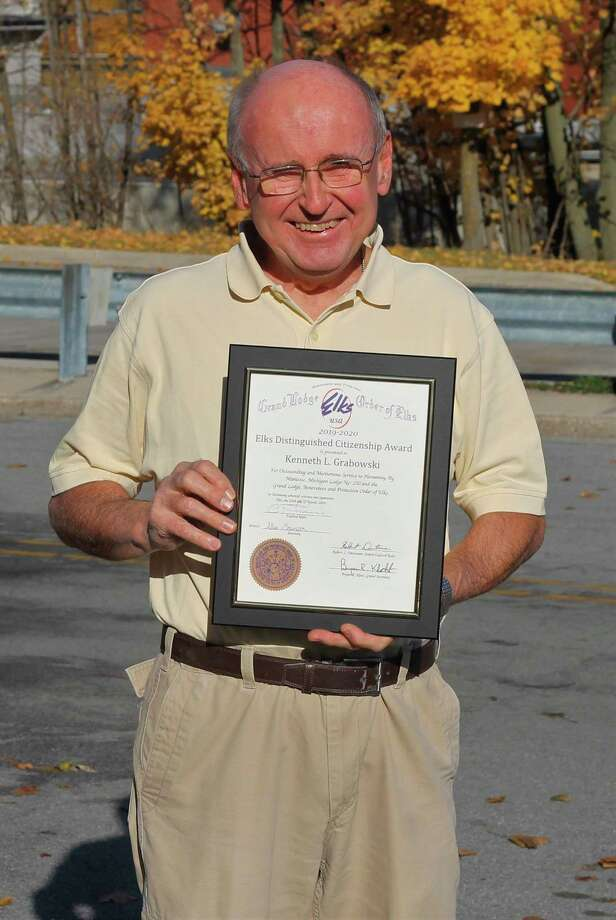 Ken Grabowski shows off the 2019-20 Distinguished Citizenship Award bestowed upon him by Elks Lodge No. 250 for his work covering community events for the Manistee News Advocate. (Kyle Kotecki/News Advocate)