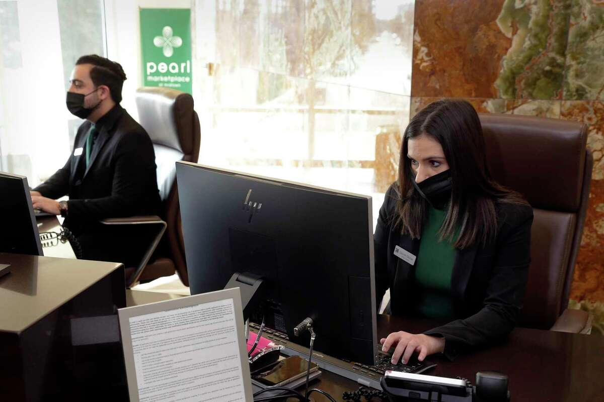 Adrian Martinez, left, and Lauren DeJoe work in the leasing office at the Pearl Marketplace, part of the Morgan Group.