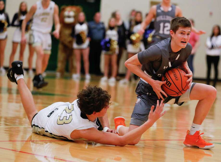 Magnolia shooting guard Connor Lindvall (11) grabs a loose ball against Lake Creek shooting guard Ty George (23) during the second quarter of a Region III-5A bi-district high school playoff game at The Woodlands High School, Tuesday, Feb. 25, 2020, in The Woodlands. Photo: Jason Fochtman, Houston Chronicle / Staff Photographer / Houston Chronicle © 2020