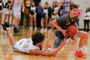 In this file photo, Magnolia shooting guard Connor Lindvall (11) grabs a loose ball last season.