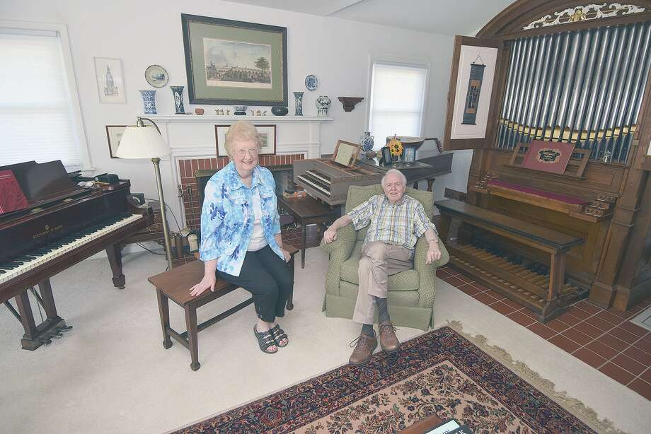 Sharon and Rudy Zuiderveld in their Jacksonville home with a 1914 Steinway piano, a Dutch harpsichord and a custom-built pipe organ. Photo: David Blanchette | Journal-Courier