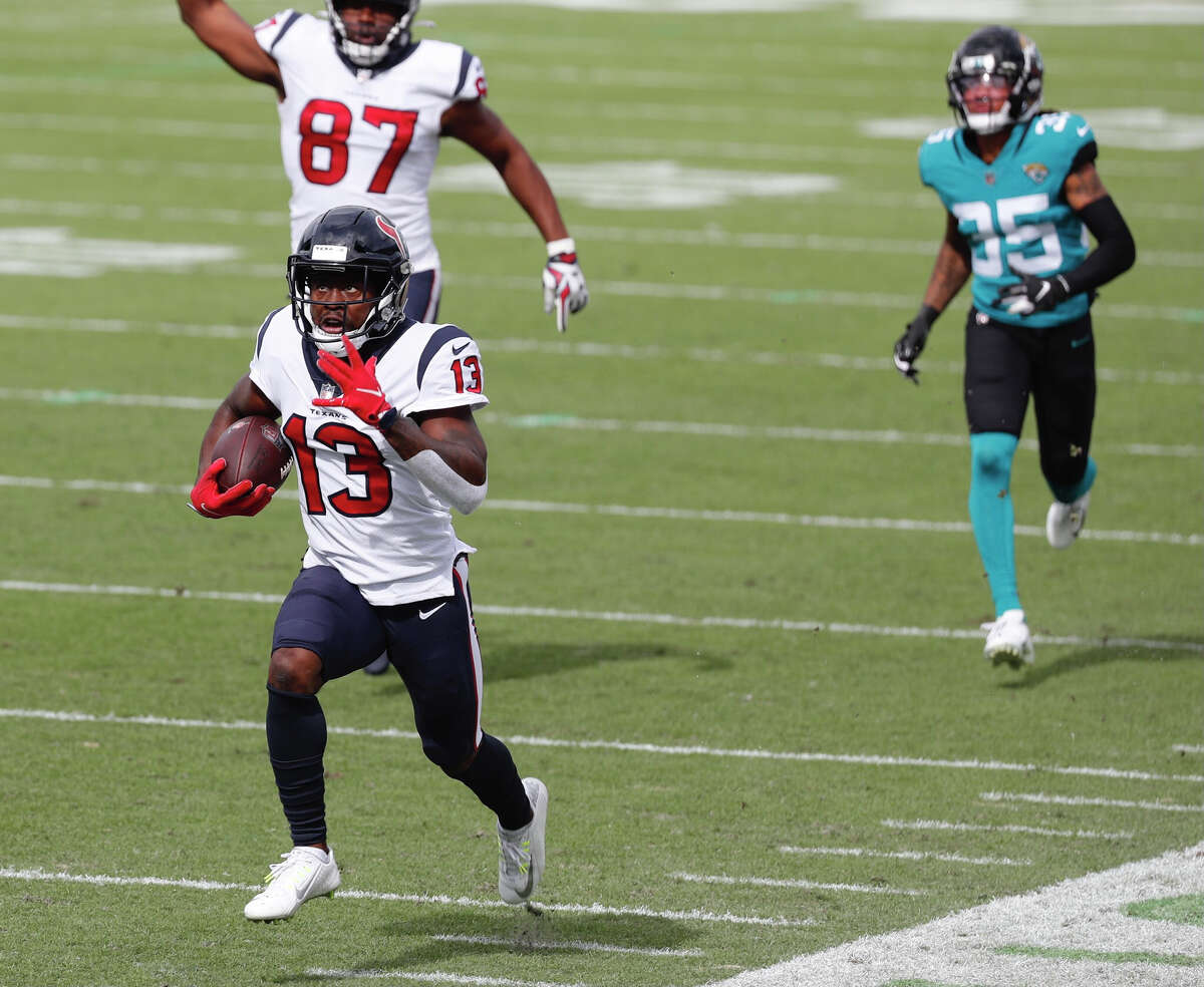 Houston Texans wide receiver Brandin Cooks races to a 57-yard touchdown reception against the Jacksonville Jaguars during the first half an NFL football game at TIAA Bank Field Sunday, Nov. 8, 2020, in Jacksonville, Fla.
