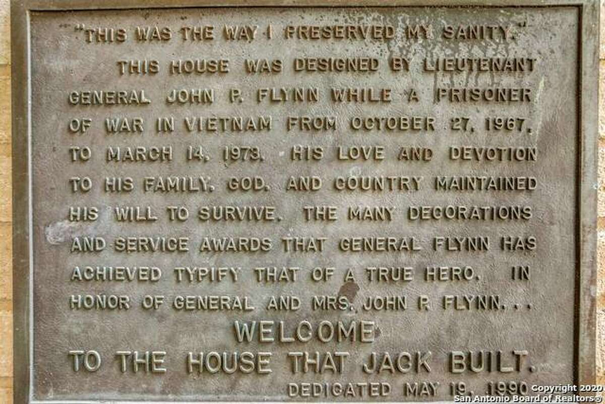 This plaque is mounted next to the front door.