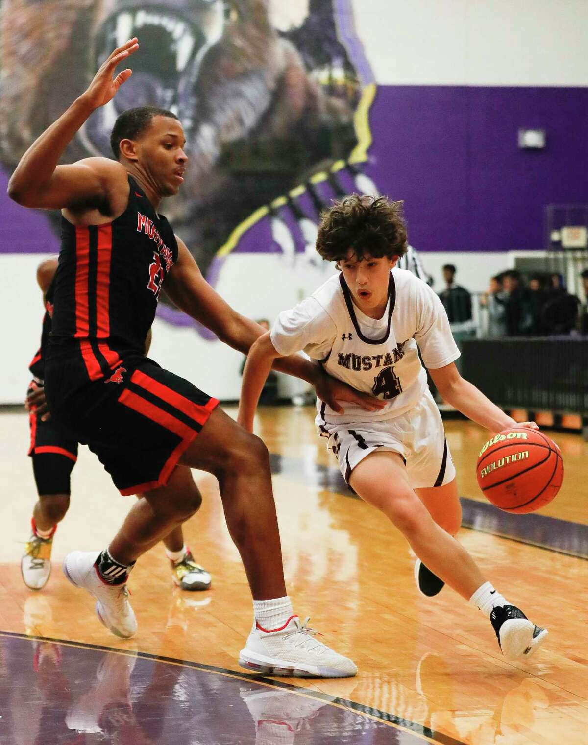 Magnolia West point guard Jacob Homer (4) drives the ball against Westfield forward Willie Williams (23) in the first quarter of a high school basketball game at the MHS Bears Holiday Classic, Thursday, Dec. 12, 2019, in Montgomery.
