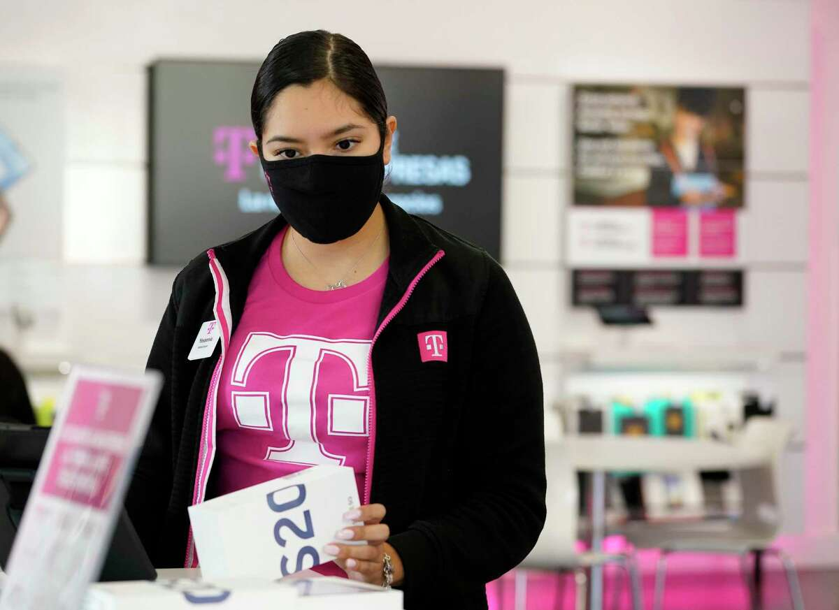 Yessenia Carmona, mobile expert, works at T Mobile, 4400 North Fwy., Monday, Aug. 12, 2020 in Houston.