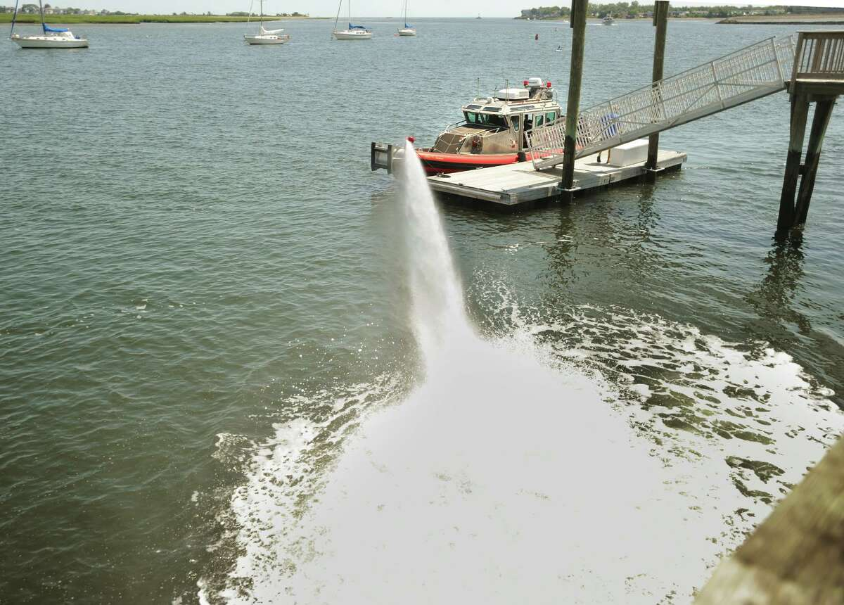 The Stratford Fire Department tests out their fire boat and its high powered water cannon from the dock at the Birdseye Street boat launch in Stratford, Conn. on Tuesday, August 1, 2017.