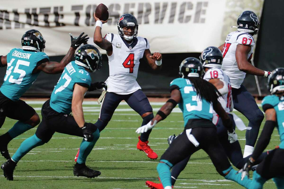 Houston Texans quarterback Deshaun Watson passes the ball against the Jacksonville Jaguars during the first half an NFL football game at TIAA Bank Field Sunday, Nov. 8, 2020, in Jacksonville, Fla.