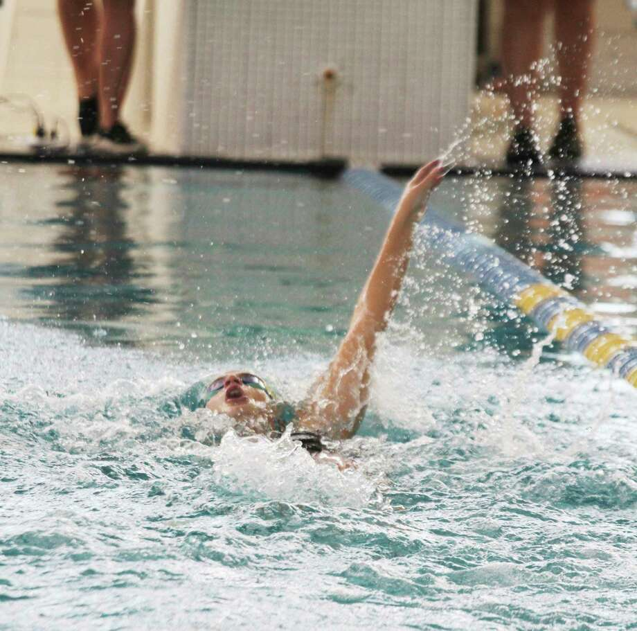 Manistee's Flaminia Coitti sets a new program record in the 100-yard backstroke on Saturday during the Coastal Swim Conference championships at the Paine Aquatic Center. (Dylan Savela/News Advocate)