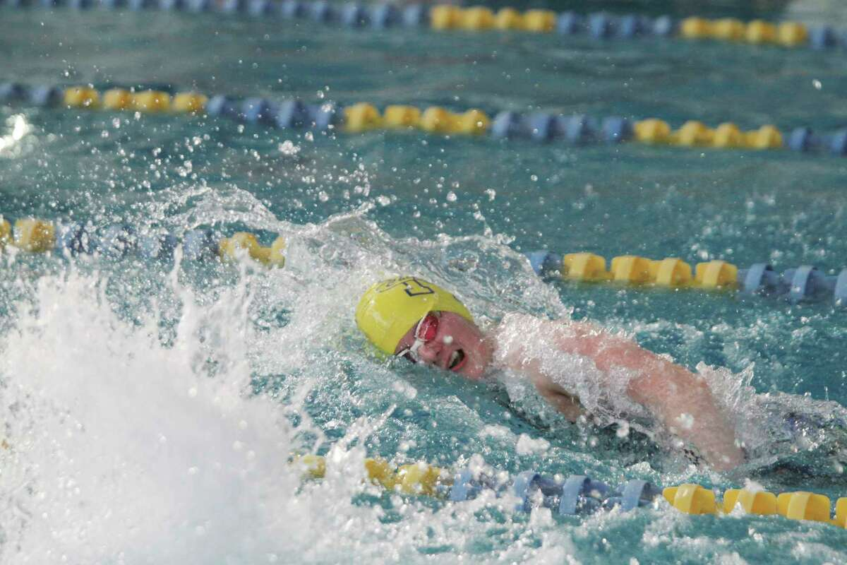 Manistee's Lauren Mendians swims the 200-yard freestyle relay during Saturday's Coastal Swim Conference championships at the Paine Aquatic Center. (Dylan Savela/News Advocate)