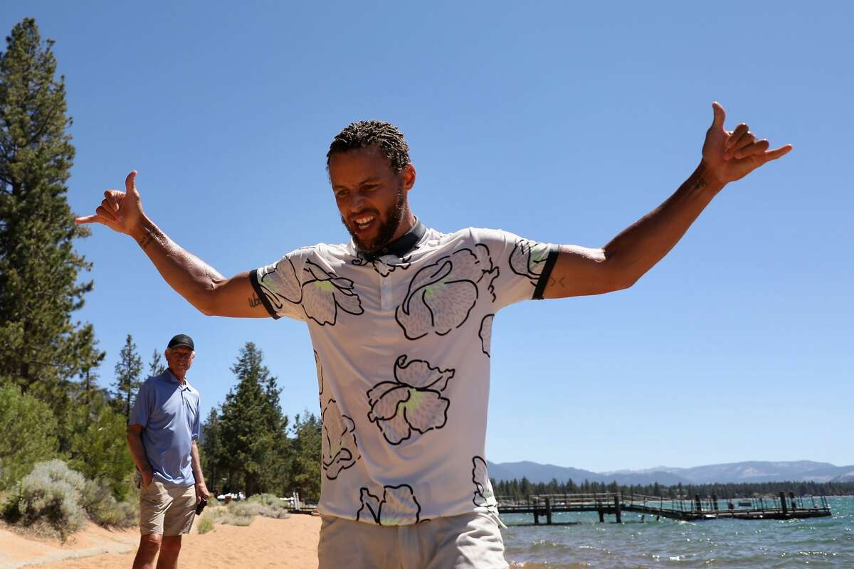 NBA athlete Stephen Curry of the Golden State Warriors reacts after jumping in Lake Tahoe following the final round of the American Century Championship at Edgewood Tahoe South course on July 12, 2020 in South Lake Tahoe, Nevada. (Photo by Christian Petersen/Getty Images)