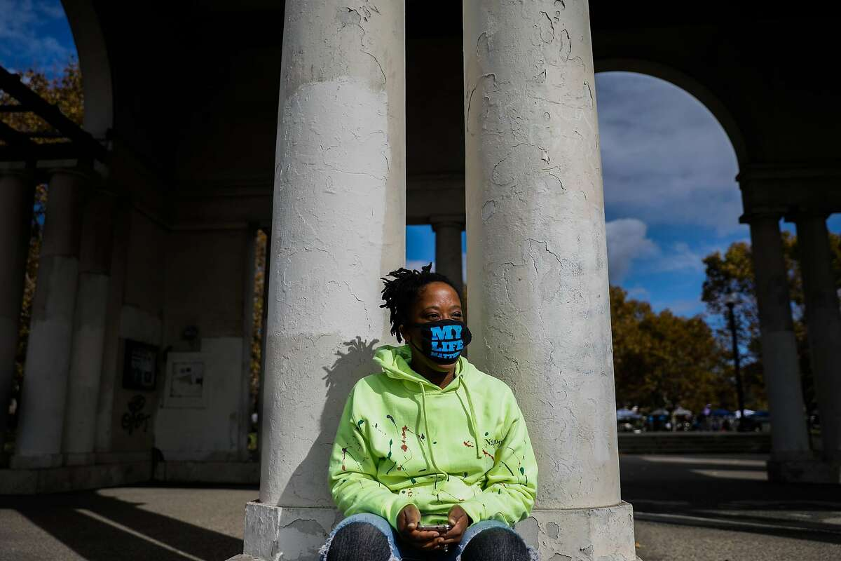 Tameka Crawford, 36, sits at Lake Merritt after speaking to the Chronicle about the Presidential election in Oakland, California on Sunday, Nov. 8, 2020.