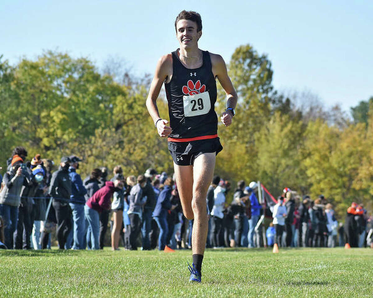 Edwardsville junior Ryan Watts doesn't bother to suppress a smile as he approaches the finish line in first place to win the Normal Class 3A Sectional on Oct. 31 at Maxwell Park in Normal. On Sunday in Chillicothe, Watts ran third in the ShaZam 2020 High School XC Championships.