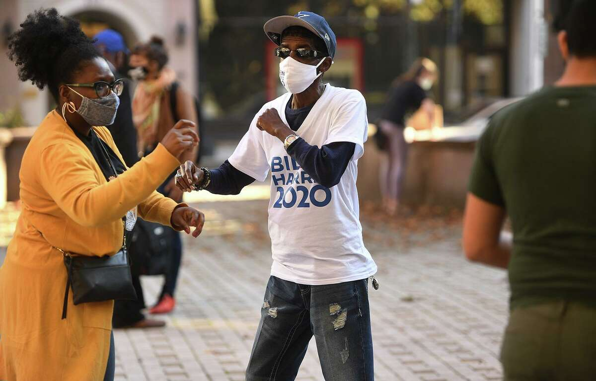 Gemeem Davis, left, and Ernie Newton, of Bridgeport, dance during the Hit the Road Jack rally on McLevy Green in Bridgeport, Conn. on Sunday, November 8, 2020.