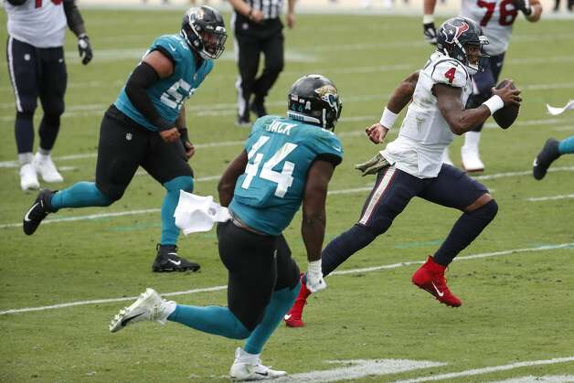 Houston Texans quarterback Deshaun Watson (4) scrambles out of the pocket against the Jacksonville Jaguars during the first half of an NFL football game at TIAA Bank Field Sunday, Nov. 8, 2020, in Jacksonville. Photo: Brett Coomer/Staff Photographer / © 2020 Houston Chronicle
