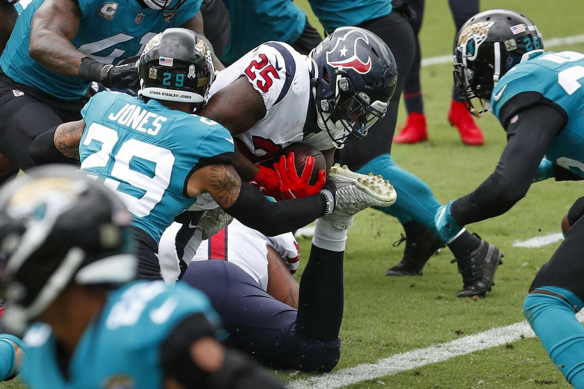 Houston Texans running back Duke Johnson (25) dives into the end zone past Jacksonville Jaguars cornerback D.J. Hayden (25) for a 1-yard touchdown run during the first half of an NFL football game at TIAA Bank Field Sunday, Nov. 8, 2020, in Jacksonville.