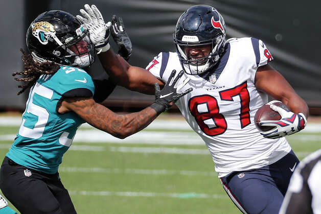 Houston Texans tight end Darren Fells (87) fights for yardage against Jacksonville Jaguars cornerback Sidney Jones (35) on a reception during the first half of an NFL football game at TIAA Bank Field Sunday, Nov. 8, 2020, in Jacksonville. Photo: Brett Coomer/Staff Photographer / © 2020 Houston Chronicle