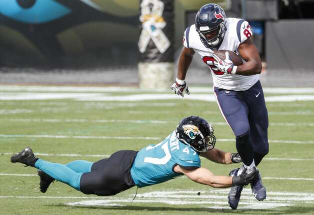 Houston Texans tight end Darren Fells (87) is tripped up by Jacksonville Jaguars middle linebacker Joe Schobert (47) during the first half of an NFL football game at TIAA Bank Field Sunday, Nov. 8, 2020, in Jacksonville. Photo: Brett Coomer/Staff Photographer / © 2020 Houston Chronicle