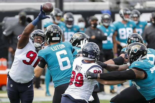 Houston Texans defensive end Carlos Watkins (91) blocks a pass by Jacksonville Jaguars quarterback Jake Luton (6) during the first half of an NFL football game at TIAA Bank Field Sunday, Nov. 8, 2020, in Jacksonville. Photo: Brett Coomer/Staff Photographer / © 2020 Houston Chronicle