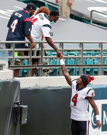 Houston Texans quarterback Deshaun Watson (4) shakes hands with Texans fans after the Texans 27-25 win over the Jacksonville Jaguars in an NFL football game at TIAA Bank Field Sunday, Nov. 8, 2020, in Jacksonville. Photo: Brett Coomer/Staff Photographer / © 2020 Houston Chronicle
