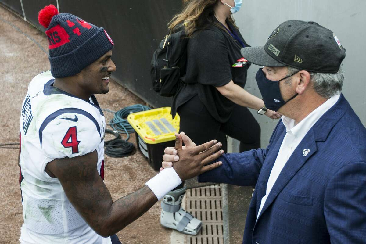 Houston Texans quarterback Deshaun Watson (4) shakes hands with Texans CEO Cal McNair after the Texans 27-25 win over the Jacksonville Jaguars in an NFL football game at TIAA Bank Field Sunday, Nov. 8, 2020, in Jacksonville.