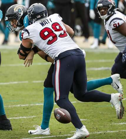 Houston Texans defensive end J.J. Watt (99) strips the ball away from Jacksonville Jaguars quarterback Jake Luton (6) as he sacks the quarterback during the second half of an NFL football game at TIAA Bank Field Sunday, Nov. 8, 2020, in Jacksonville. The sack was Watt's 100th career sack. Photo: Brett Coomer/Staff Photographer / © 2020 Houston Chronicle