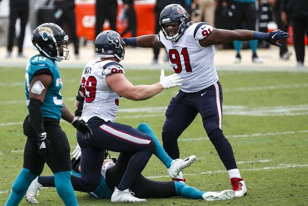 Houston Texans defensive end J.J. Watt (99) and Houston Texans defensive end Carlos Watkins (91) celebrate after Watt sacked Jacksonville Jaguars quarterback Jake Luton during the second half of an NFL football game at TIAA Bank Field Sunday, Nov. 8, 2020, in Jacksonville. The sack was Watt's 100th career sack. Photo: Brett Coomer/Staff Photographer / © 2020 Houston Chronicle