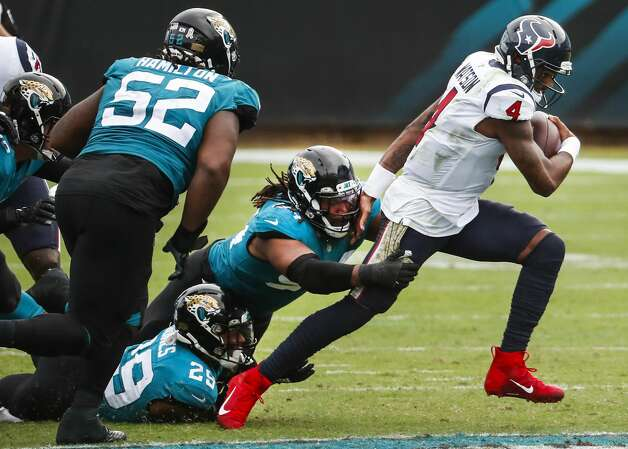 Houston Texans quarterback Deshaun Watson (4) breaks away from the Jacksonville Jaguars defense to avoid a sack during the second half of an NFL football game at TIAA Bank Field Sunday, Nov. 8, 2020, in Jacksonville. Photo: Brett Coomer/Staff Photographer / © 2020 Houston Chronicle