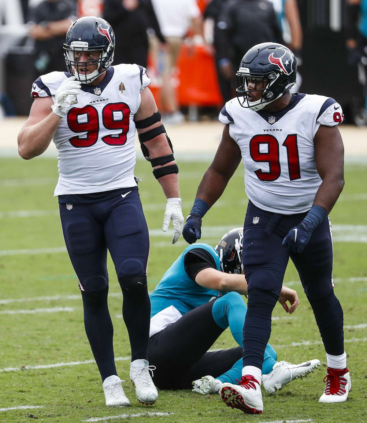 Houston Texans defensive end J.J. Watt (99) and Houston Texans defensive end Carlos Watkins (91) celebrate after Watt sacked Jacksonville Jaguars quarterback Jake Luton during the second half of an NFL football game at TIAA Bank Field Sunday, Nov. 8, 2020, in Jacksonville. The sack was Watt's 100th career sack.