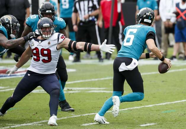 Jacksonville Jaguars quarterback Jake Luton (6) steps just out of the reach of Houston Texans defensive end J.J. Watt (99) during the second half of an NFL football game at TIAA Bank Field Sunday, Nov. 8, 2020, in Jacksonville. Photo: Brett Coomer/Staff Photographer / © 2020 Houston Chronicle