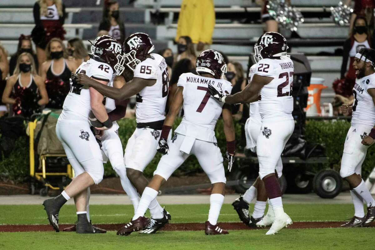 Texas A&M,s Max Wright (42), Jalen Wydermyer (85), Moose Muhammad III (7) and Darvon Hubbard (22) celebrate a touchdown during the second half of the Aggies' 48-3 drubbing of South Carolina.