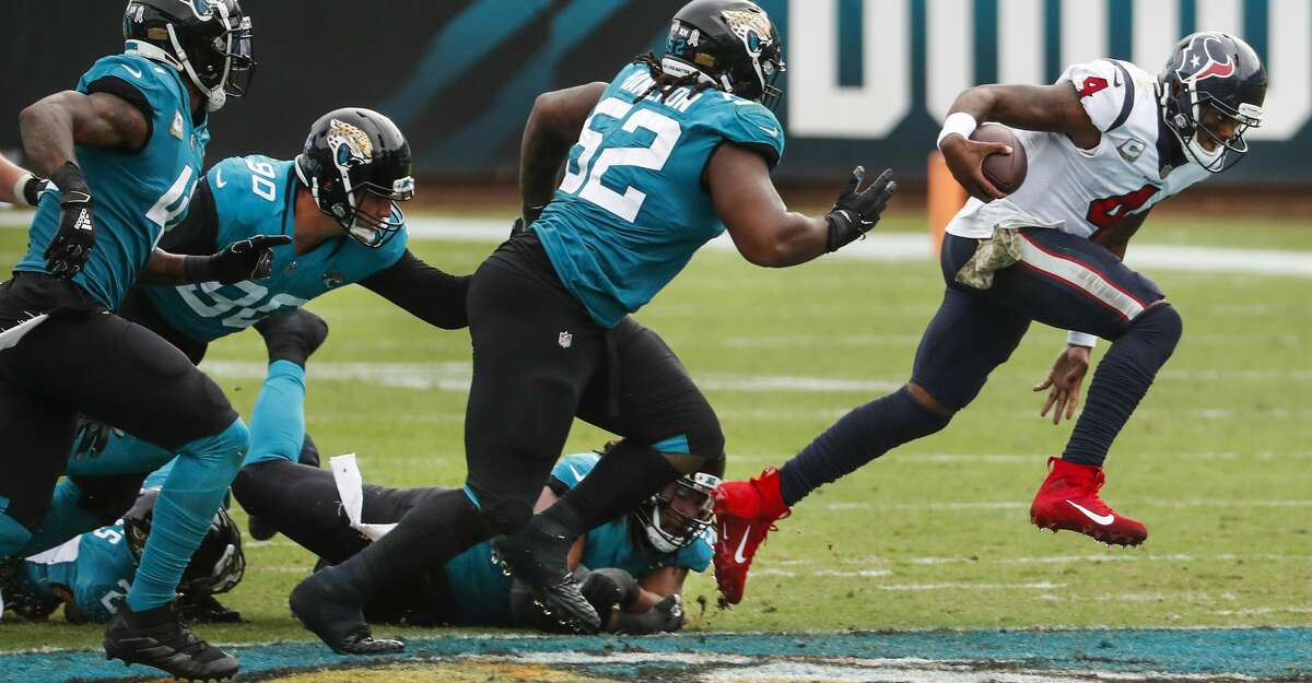 Houston Texans quarterback Deshaun Watson (4) breaks away from the Jacksonville Jaguars defense to avoid a sack during the second half of an NFL football game at TIAA Bank Field Sunday, Nov. 8, 2020, in Jacksonville.