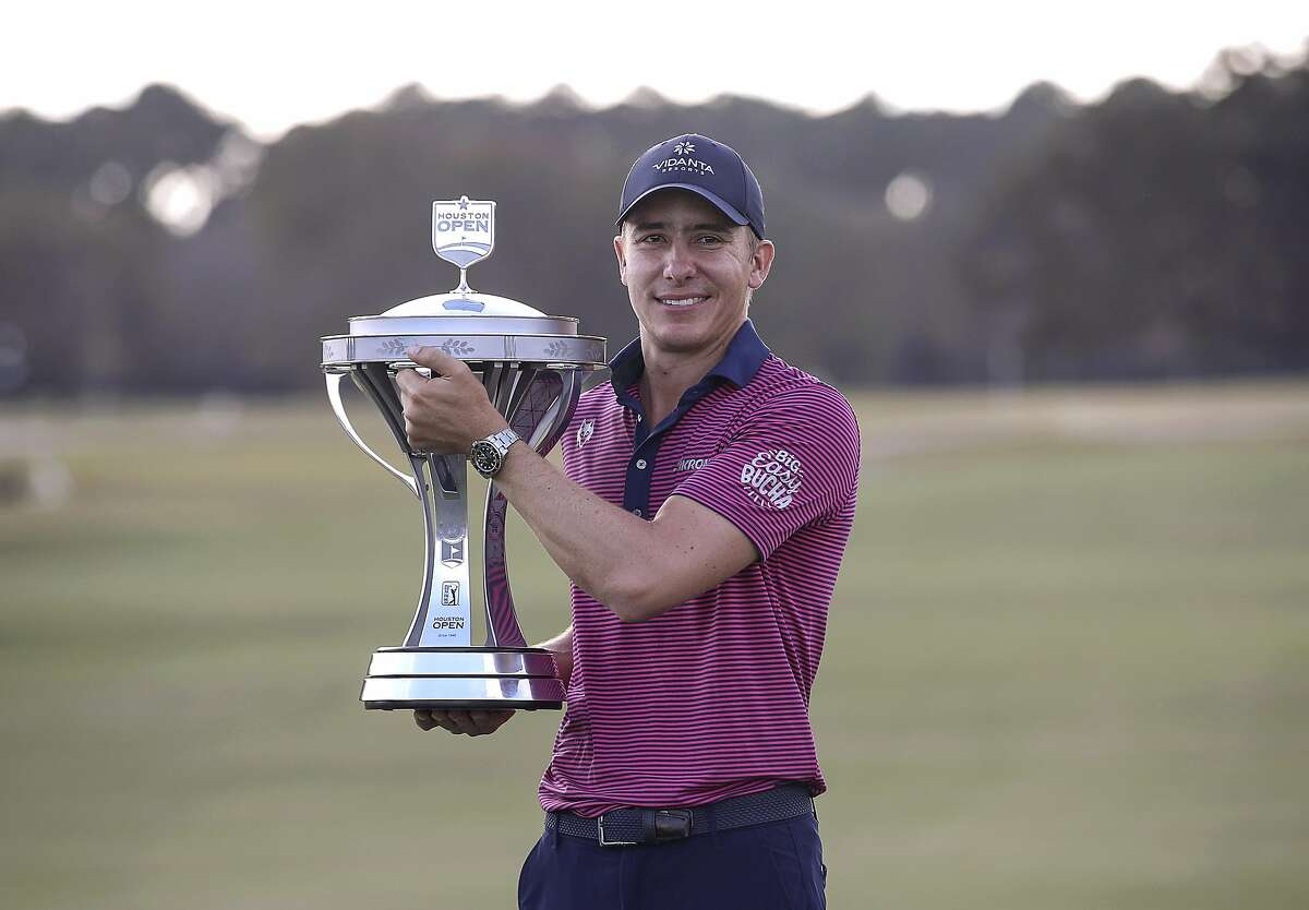 Carlos Ortiz poses with the champion's trophy after winning the Houston Open on Sunday, Nov. 8, 2020, at Memorial Park Golf Course in Houston.