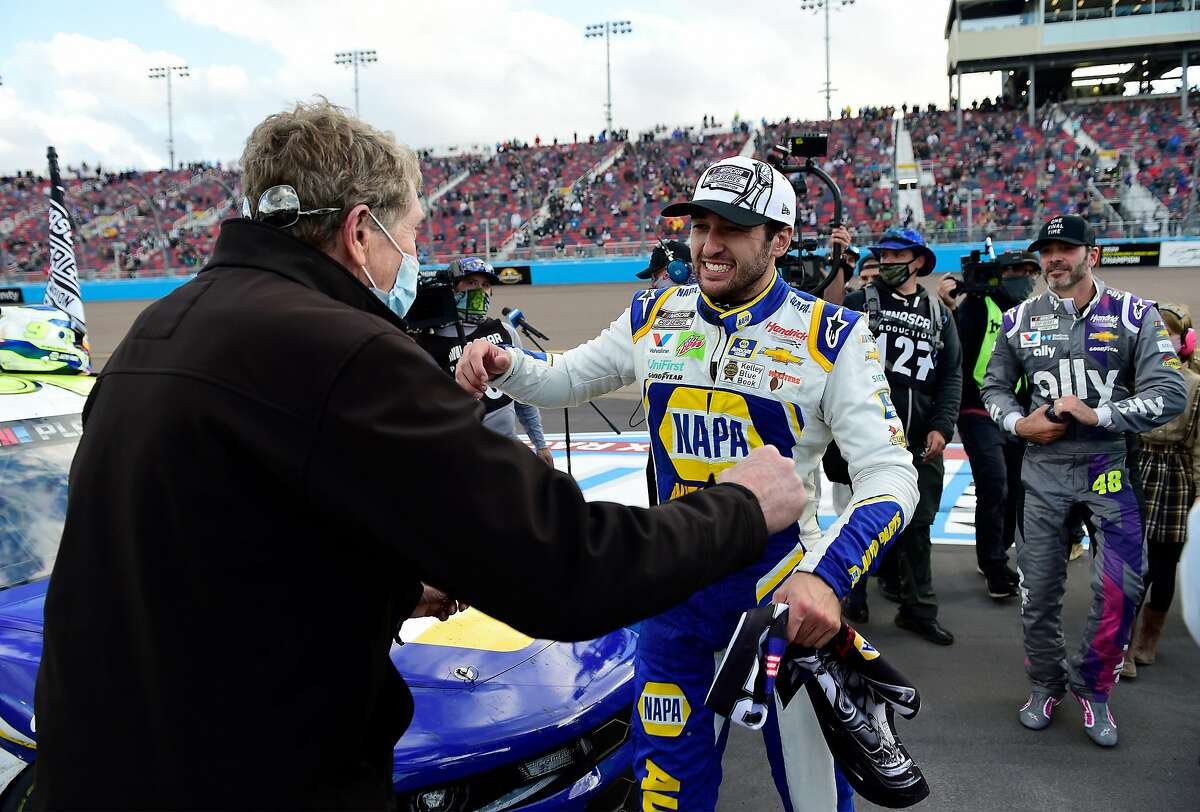 Chase Elliott greets his father, Bill, after winning the NASCAR finale and Cup Series championship at Phoenix Raceway in Avondale, Ariz. They're the third father-son combination to win a NASCAR Cup title.