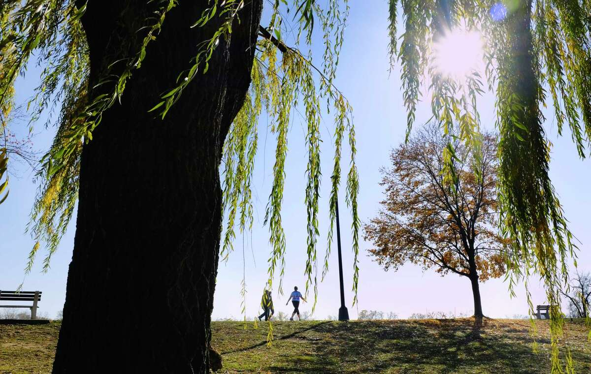 Women walk through the Corning Preserve on Sunday, Nov. 8, 2020, in Albany, N.Y. (Paul Buckowski/Times Union)