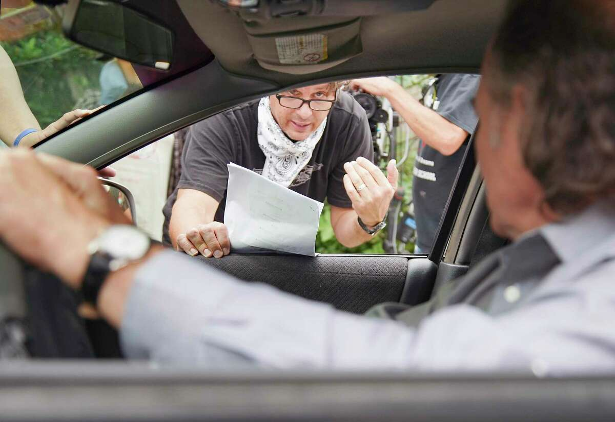 Director Johnny Ray Gibbs goes over a scene with actor David Born in the parking lot of Bambalinos Pizza in Houston on Sunday, Nov. 8, 2020.