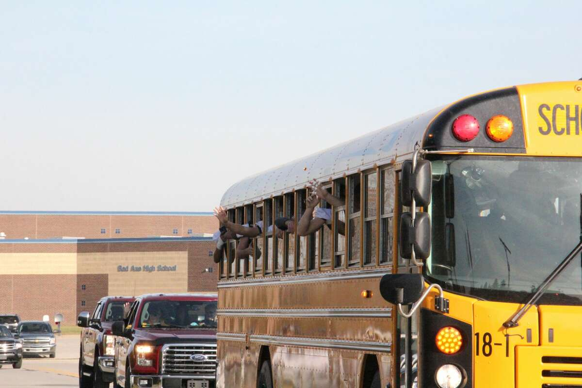 The Bad Axe football team was escorted from the school Saturday November 7 on their way to play the Hemlock Huskies in the district semifinals. Many fanscame out to wish the players well.