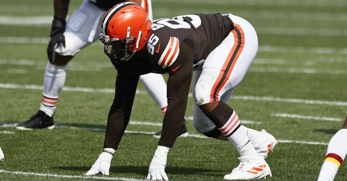 Cleveland Browns defensive end Myles Garrett (95) plays against the Washington Football Team during the first half of an NFL football game, Sunday, Sept. 27, 2020, in Cleveland. (AP Photo/Ron Schwane)